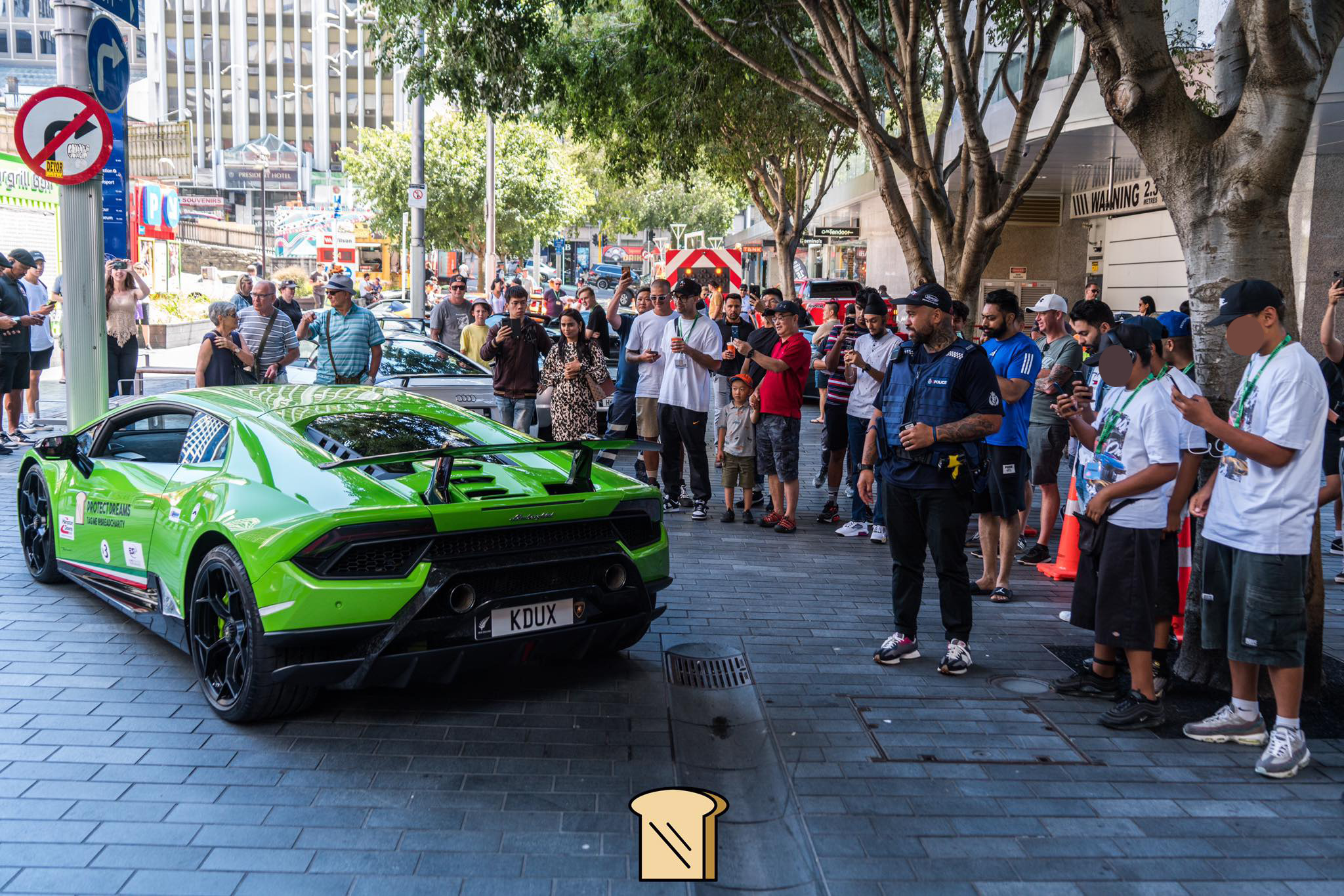 Kids at the supercar rally with Police